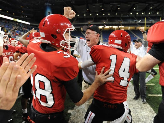 Orchard Lake St Mary's head coach George Porritt celebrates