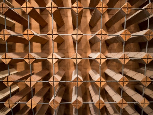Wine racks were repurposed from a home on Doctor's