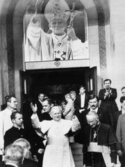 Pope John Paul II waves to the crowd in <137,2014/04/26,Keller/c Ilana1>during his 1979 visit to<137> Philadelphia in 1979. <137>Associated Press file<137>