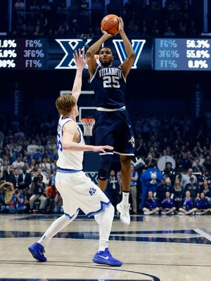 Villanova Wildcats guard Mikal Bridges (25) shoots during the first half against the Xavier Musketeers guard J.P. Macura (55) at the Cintas Center.