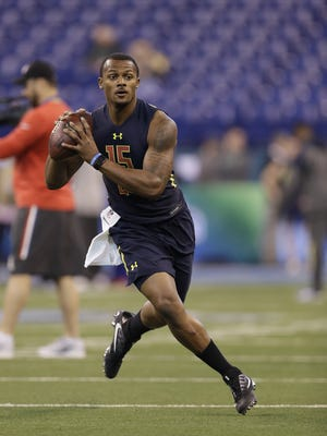Clemson quarterback Deshaun Watson throws a pass on the run at the NFL Scouting Combine on Saturday.