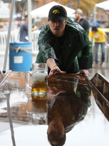 Scott Birney takes aim at the beer slide at Oktoberfest on Saturday, Sept. 28, 2013.