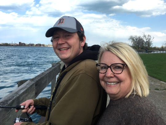 Sylvia Rector is with son Zack Hill while he fishes at Belle Isle in May 2016