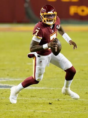 Washington Football Team quarterback Dwayne Haskins runs with the ball during the first half of Sunday's game against the Carolina Panthers in Landover, Md. The team released the 15th overall pick in the 2019 NFL Draft on Monday.