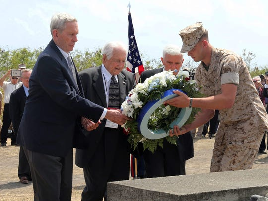 U.S. veterans lay a wreath on March 21, 2015, during a ceremony commemorating the 70th anniversary of the battle on Iwo Jima, now known as Ioto, Japan.