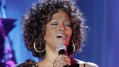 Whitney Houston performs at the Clive Davis pre-Grammy party in Beverly Hills, Calif.  A CD/DVD featuring Whitney Houston?s first public performance and her last one in 2012 will be released on Nov. 11, 2014. ?Whitney Houston Live: Her Greatest Performances? is the late singer?s first live album. Her mentor, Clive Davis, said the album will showcase the best-selling singer?s legacy.