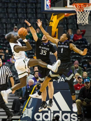 Che Bob, one of three CSU basketball players ruled ineligible for the spring semester, puts up a shot during a Dec. 17 game in Denver against Kansas State. Davocio Butler and Kimani Jackson also were declared ineligible, beginning with the start of the spring semester Jan. 17.