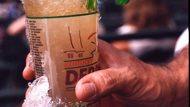 Derby Day 1992, patron with mint julep.  for Sporting News.