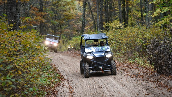 ATV enthusiasts take to the trails following a meeting on proposed trail extensions near Camp Ripley and Little Falls Friday, Oct. 7, on an ATV trail near Randall.