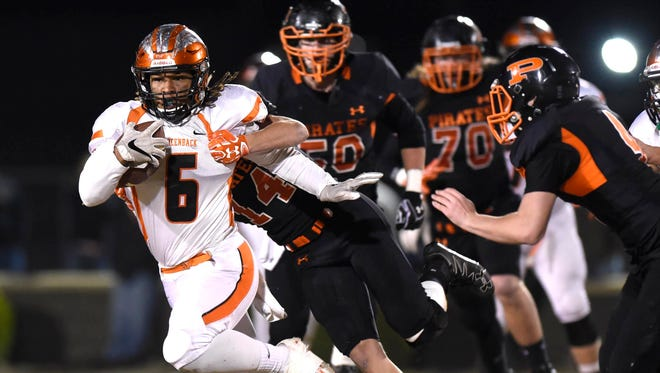 Greenback's Breeden Gilbert, left, is brought down from behind by South Pittsburg's Jess Morrison on Friday in a Class A semifinal game at South Pittsburg