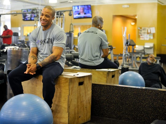 Personal Trainer Brendan Brown, 35, of Bear, left, smiles as his client, Harry Bryant, 67, of Bear, whom he works with once a week at Anytime Fitness in Bear Thursday, February 25, 2016. Bryant began working out at the facility four times a week in order to better control his Type II Diabetes.