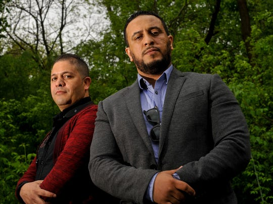 Ahmed Chebli, of Champion Taxi (left) and Hamid Massari, of Blue Hans UD Taxi Service, are shown in Newark on May 6. Drivers for app-based car services in Delaware are not subject to any permitting requirement beyond a driver's license.