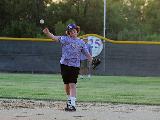 Wylie Junior League All-Star Riley Hood throws to first