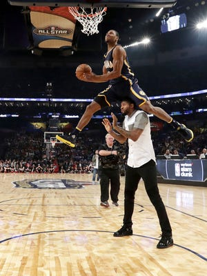 Indiana Pacers' Glenn Robinson III goes over teammate Paul George during the slam dunk contest at NBA All-Star Saturday Night in New Orleans, Saturday, Feb. 18, 2017.(Ronald Martinez/Pool via AP)