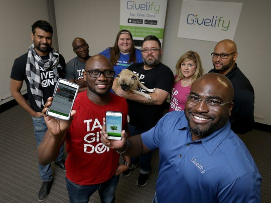Givelify founder/CEO Wallie Mafolasire,left, and co-founder