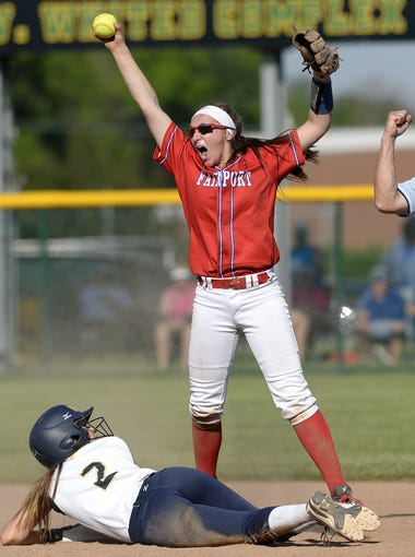 Fairport's Megan Palmer, top, celebrates after recording an out on an attempted steal by Victor's Sydney Powell during the Section V Class AA championship game at SUNY Brockport, Wednesday, May 30, 2018. No. 1 seed Victor won the Class AA title with an 11-2 win over No. 2 seed Fairport.