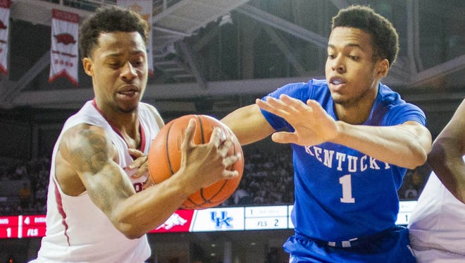 Jan 21, 2016; Fayetteville, AR, USA; Arkansas Razorbacks guard Anthlon Bell (5) grabs a loose ball from Kentucky Wildcats forward Skal Labissiere (1) during the second half of play at Bud Walton Arena. The Wildcats won 80-66. Mandatory Credit: Gunnar Rathbun-USA TODAY Sports