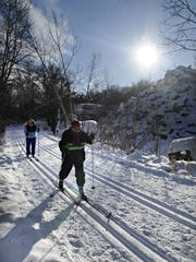 Skiers on a sunny day at Quarry Park & Nature Preserve in Waite Park in January 2013.