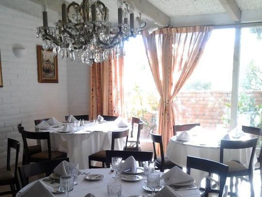 The dining room at French restaurant Le Sans Souci