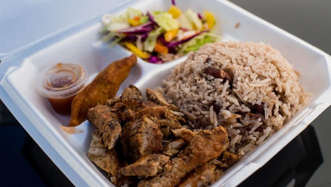 The Jerk Pork Plate is plated for lunch during the E's Kitchen Food Truck Roundup at Parc Lafayette in Lafayette, La., Saturday, Oct. 3, 2015.