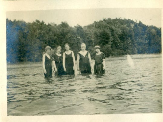 Ladies wading in the water near the Lang family camp on Malletts Bay.