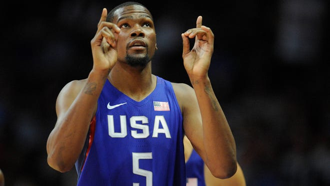 USA guard Kevin Durant (5) checks in before playing against China in the first half during an exhibition basketball game at Staples Center.