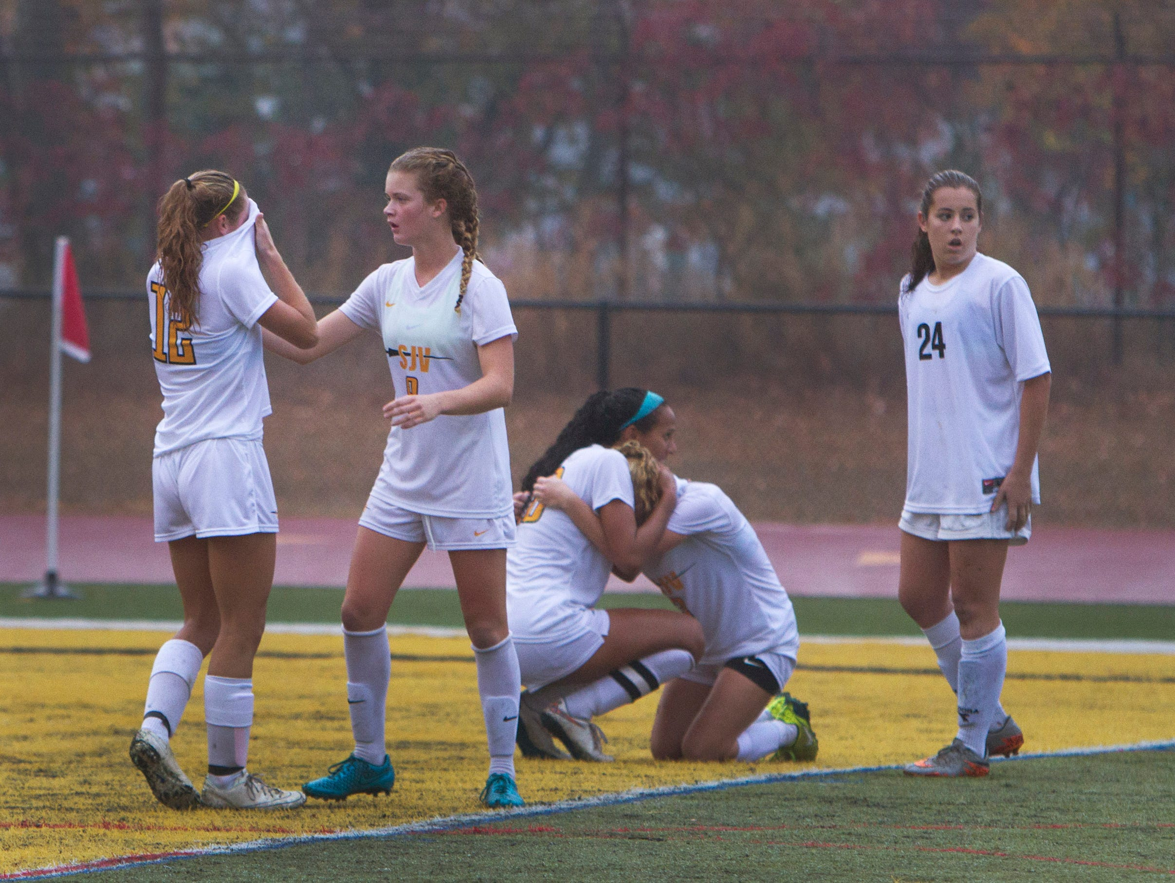 St. John Vianney players sit in their goal stunned as the game ends and they lose to Red Bank Catholic. Red Bank Catholic vs St. John Vianney in NJSIAA State Soccer tournament
