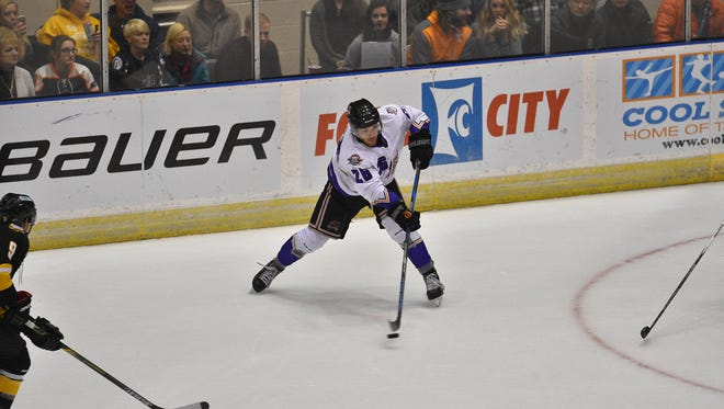 Knoxville center Doug Reid handles the puck during Saturday's game against Mississippi at Civic Coliseum.