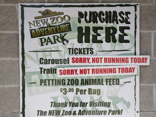 A sign near the entrance of the NEW Zoo in Suamico alerts visitors to rides that are not in service due to lack of trained staff to operate them.
