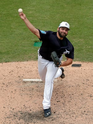 Tigers pitcher Michael Fulmer pitches in the seventh inning of the Tigers' 10-3 exhibition win over the Braves on Sunday, March 25, 2018, in Lakeland, Fla.
