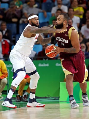 Venezuela power forward Nestor Colmenares (43) handles the ball against United States center Demarcus Cousins (12) during the men's basketball preliminary round in the Rio 2016 Summer Olympic Games at Carioca Arena 1 in Rio de Janeiro on Monday, Aug. 8, 2016.