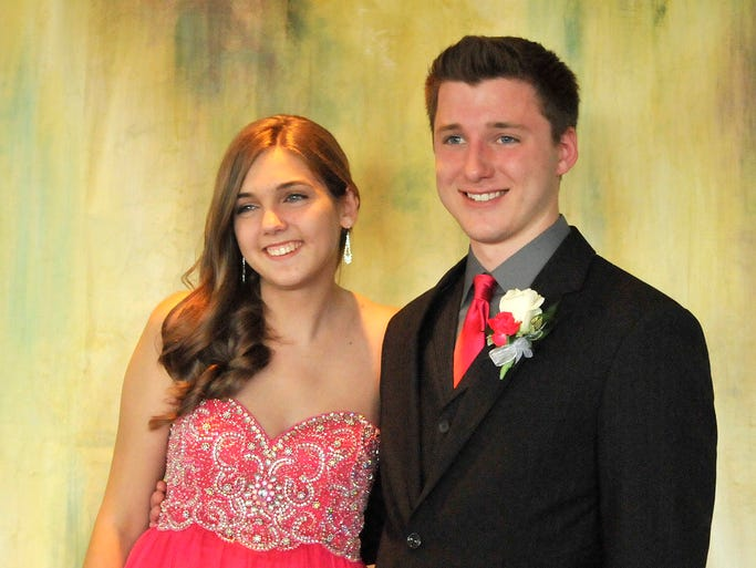 Cela Schmit and her date Blake Addison smile for pictures at Blackberry Ridge Golf Course on Saturday.