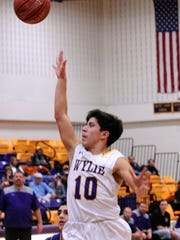 Wylie guard Steven Lopez lets go of a shot in the lane against Wolfforth Frenship on Thursday night. The Bulldogs won 60-41.