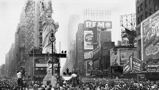 Thousands of people celebrate VJ Day on Aug. 14, 1945, in New York's Times Square after Japanese radio reported acceptance of the Potsdam declaration.