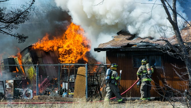 Doña Ana County firefighters fight a fire on Old Picacho Road with the assistance of the Las Cruces Fire Department in 2016.