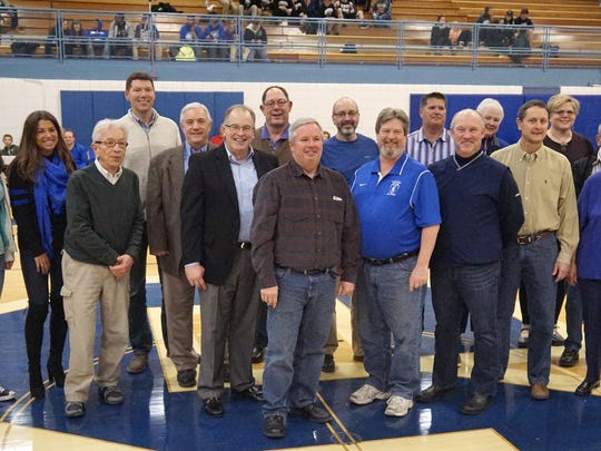 Salem Wall of Champions honorees (from left) Tiffany Grubaugh, Jordan Falcusan, Chuck Olson, Ron Orris, Dennis (Doc) O'Connor, Doug Tripp, Rick Gladstone, Jerry Brink, Dan Ross, Darrell Rowe, Mike Moshimer, Doug Ward, Gloria Shelton (Fred Thomann's sister), Tim Dillon, Tanya Thomann, Gary Shelton, Mary Ann Thomann and Rich Hewlett. They were introduced at halftime of the Salem boys basketball game.