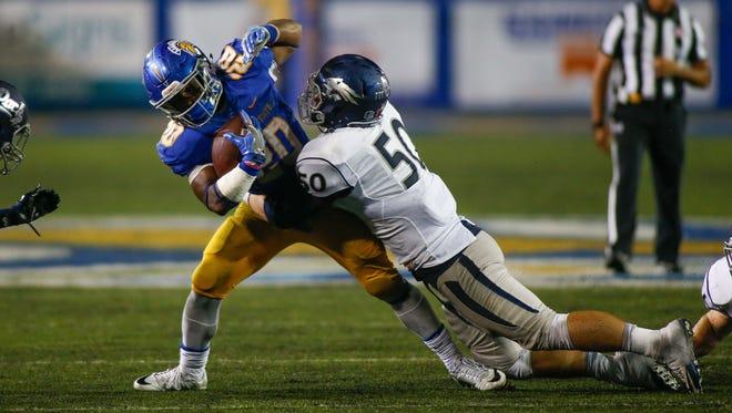 Wolf Pack linebacker Austin Paulhus tackles San Jose State running back Malik Roberson during their game last week.
