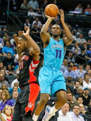 Charlotte Hornets forward Noah Vonleh,  right, shoots against the Toronto Raptors on April 8, 2015 in Charlotte, N.C.