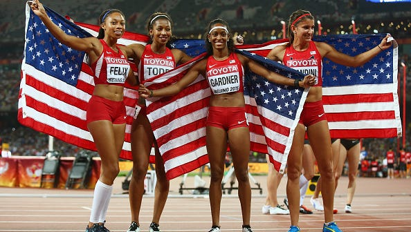 Jasmine Todd of Chandler, second from left, and her U.S. teammates won silver in the 400-meter relay Saturday at the World Track Championships.