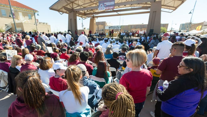Many fans gather to support the NMSU football team at Plaza de Las Cruces on Saturday January 20, 2018, during an Aggies celebration.