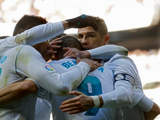 Real Madrid's Cristiano Ronaldo celebrates with teammates after scoring the opening goal against Alaves during the Spanish La Liga soccer match between Real Madrid and Alaves at the Santiago Bernabeu stadium in Madrid, Saturday, Feb. 24, 2018. (AP Photo/Francisco Seco)