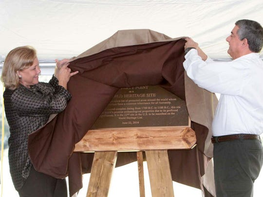 Jonathan Jarvis, U.S. Park Service, U.S. Sen. Mary Landrieu and Lt. Gov. Jay Dardenne unveil the plaque announcing Poverty Point World Heritage Site at an inscription ceremony on Saturday, October 11, 2014, at the ancient earthen mounds near Epps.