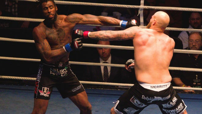 Dakota Merritt and Seante Williams exchange punches during their MMA bout Friday night in Island Fights 39
