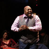 "As Felicia P. Fields listens, Caron ""Sugaray"" Rayford grabs the emotions of a fiery blues tune in the Cincinnati Playhouse in the Park's production of Low Down Dirty Blues, which continues through Dec. 20 in the Playhouse's Thompson Shelterhouse Theatre."
