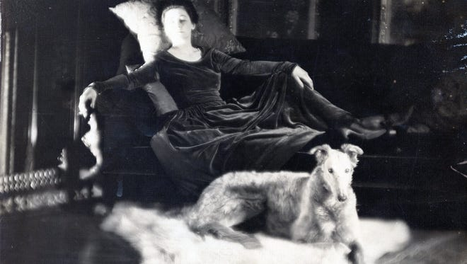 Lois Kellogg and her wolfhound, circa 1915.