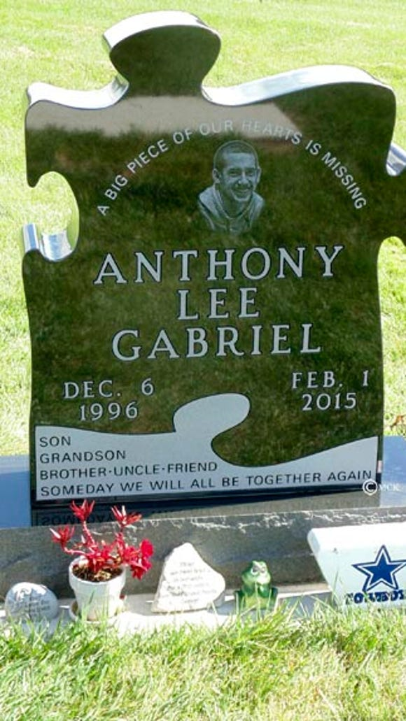 Anthony Gabriel's tombstone, in the shape of a puzzle piece, at Woodlawn Cemetery. in Sioux Falls.