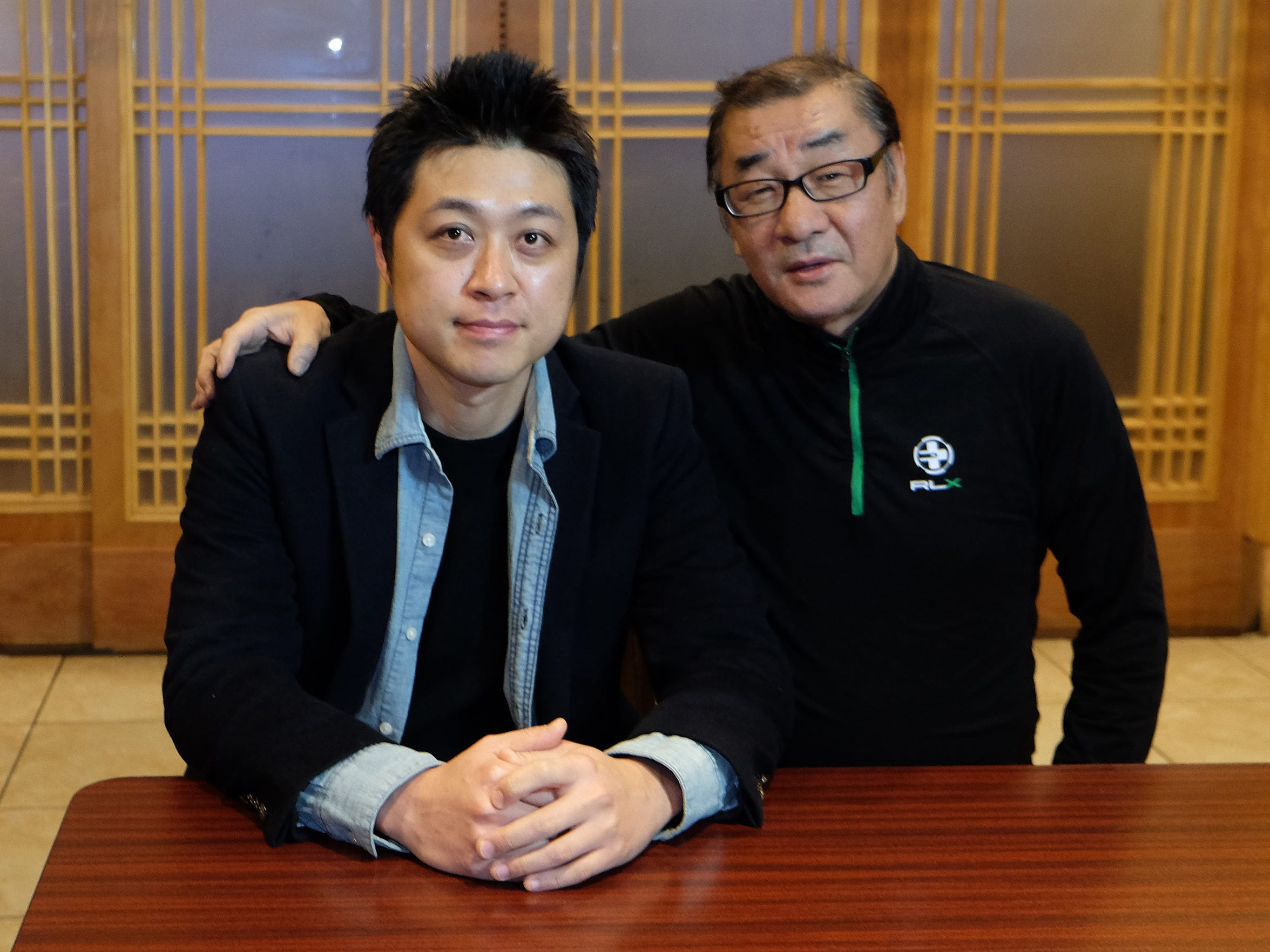 Owner Joe Yoon, right, and son Daniel Yoon at Chung Ki Wa in Sterling Heights.
