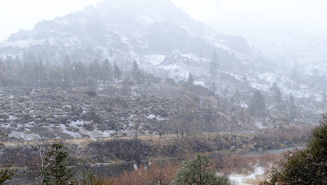 A file photo of snow falling just east of Truckee  from Interstate 80. National Weather Service forecasters expect a mix of snow and rain showers on Wednesday into Thursday followed by another snowfall over the weekend.