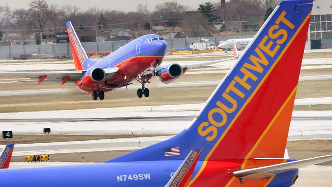 A Southwest Airlines jet takes off at an airport.