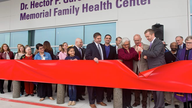 Cecilia Garc'a Akers, daughter of Dr. Hector P. Garcia and Justin Doss, chief operating Officer for Christus Spohn Health System, cut the ribbon at  ribbon-cutting ceremony Saturday, Feb. 4, 2017, for Christus Spohn's new Dr. Hector P. Garcia Memorial Family Health Center.